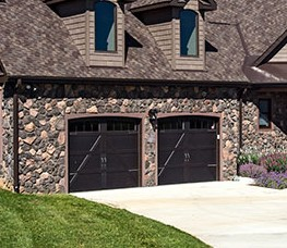 Stone exterior of garage door on Sylvan - House Plan #1321